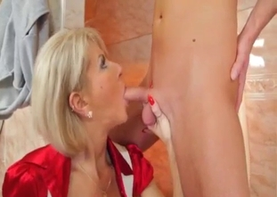 Mom sensually sucks her son dick in the bathroom