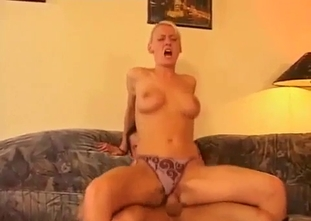 Fake boobed mom rides her son like a cowgirl