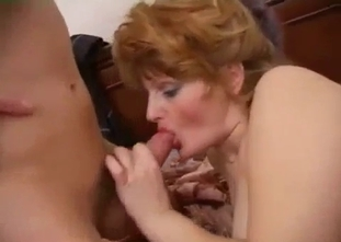 Redhead mom with nice tits enjoys her son