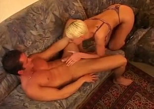 Fake boobed blonde performs a blowjob for her cousin