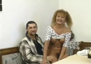 Big boobed mom undresses for her horny son