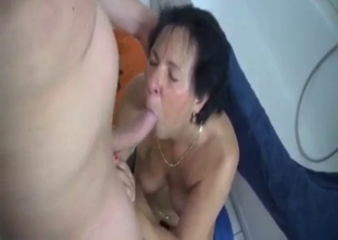 Dark haired mommy performs a head for a son